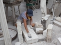 Hanna Gigling inspecting marble stone